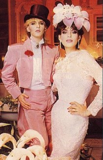 Duran Duran's Nick Rhodes marrying Julie Ann Friedman in the early 80s. Pink flamingos, pink tux, pink lipstick.