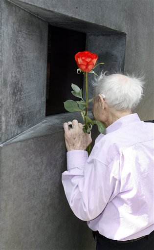 Rudolf Brazda, survivor of the Holocaust, looks at a video installation inside the memorial for the homosexual victims of persecution by the Nazi regime in Berlin, Germany, Friday, June 27, 2008 during a visit at the memorial together with the mayor of Berlin, Klaus Wowereit. (AP Photo/Michael Sohn)