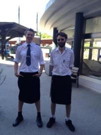Swedish train drivers Martin Akersten and Edward Elvefors pose wearing a skirt at work. Stockholm, 2013.