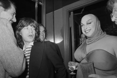 Mick Jagger and Divine attending Andy Warhol's pre-opening party at Manhattan's Copacabana nightclub, New York, October 14, 1976.
